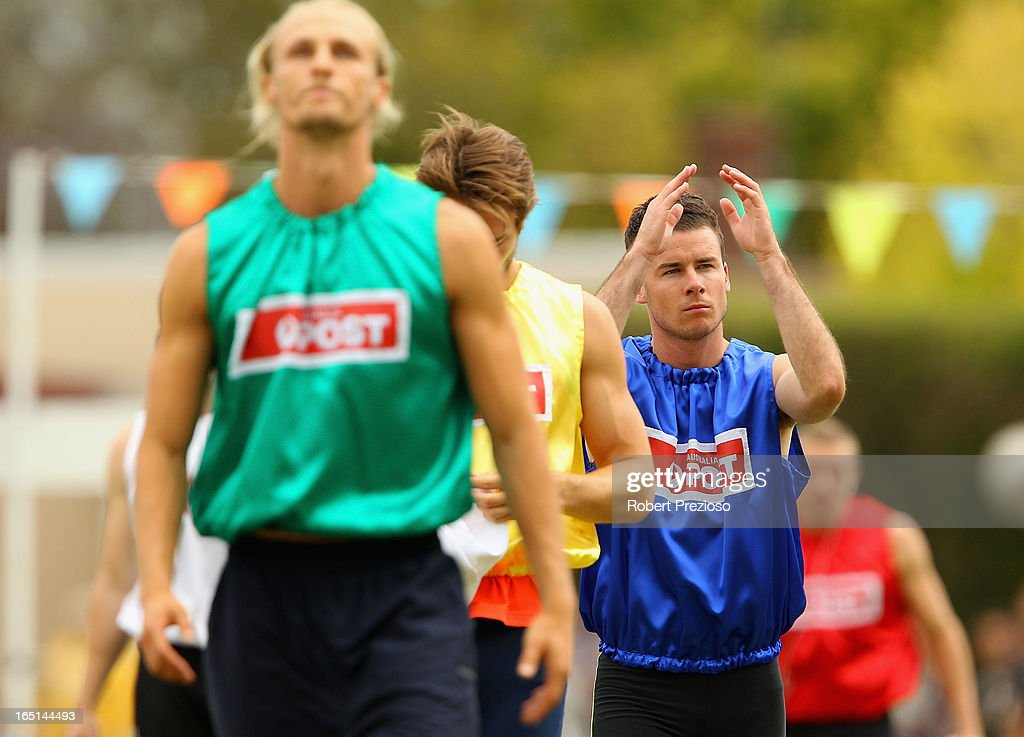 Andrew Robinson of Tasmania (blue) prepares for the Australia Post Stawell Gift 120m Final during the 2013 Stawell Gift carnival at Central Park on April 1, 2013 in Stawell, Australia.