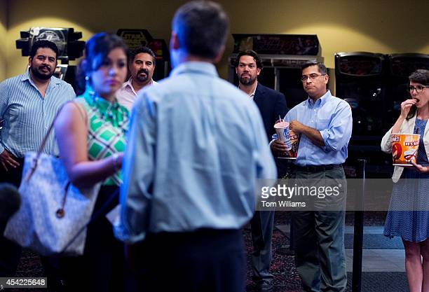 Andrew Romanoff Democratic candidate for Colorado's 6th Congressional District is interviewed as from left coowners Cesar Sanchez Roberto Sanchez...