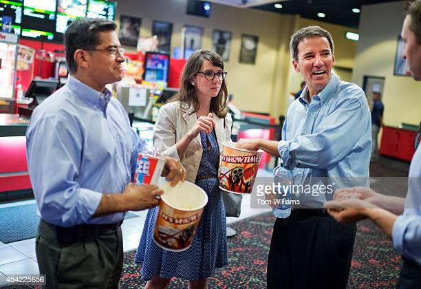 Andrew Romanoff right Democratic candidate for Colorado's 6th Congressional District aide Denise Baron and Rep Xavier Becerra DCalif are given a tour...