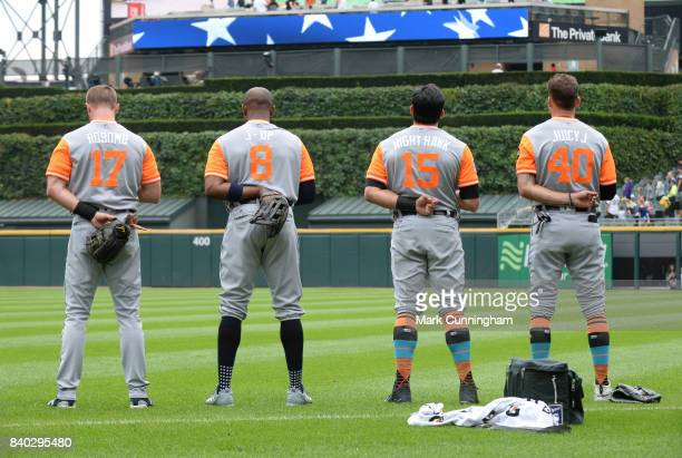 Andrew Romine Justin Upton Mikie Mahtook and JaCoby Jones of the Detroit Tigers stand together on the field during the National Anthem while wearing...