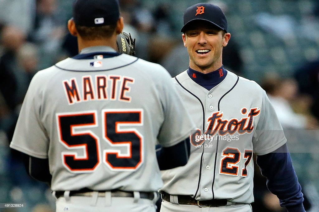Andrew Romine #27 of the Detroit Tigers (R) and Jefry Marte #55 celebrate their win against the Chicago White Sox at U.S. Cellular Field on October 4, 2015 in Chicago, Illinois. The Detroit Tigers won 6-0.