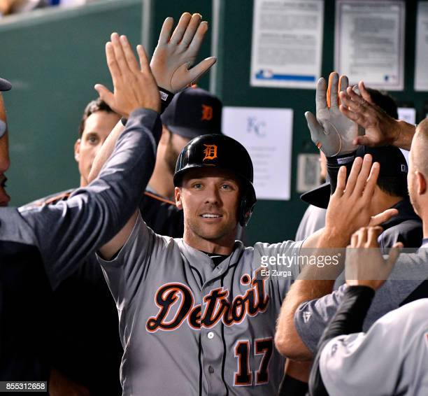 Andrew Romine of the Detroit Tigers celebrates with teammates after scoring in the fifth inning against the Kansas City Royals at Kauffman Stadium on...