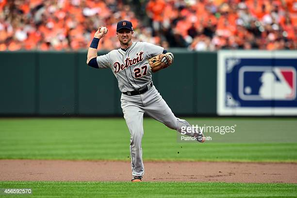 Andrew Romine of the Detroit Tigers fields the ball on hit by Steve Pearce of the Baltimore Orioles in the second inning during Game Two of the...