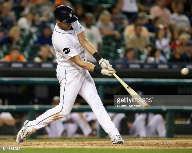 Andrew Romine of the Detroit Tigers hits a solo home run against the Toronto Blue Jays during the ninth inning at Comerica Park on July 14 2017 in...