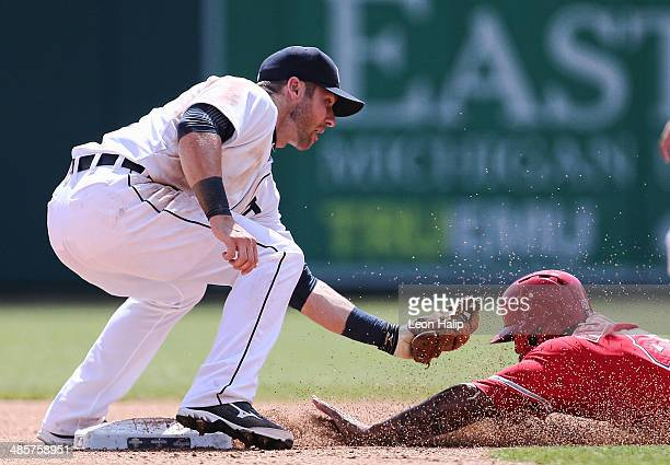 Andrew Romine of the Detroit Tigers puts the tag on Howie Kendrick of the Los Angeles Angels of Anaheim during the fourth inning of the game at...