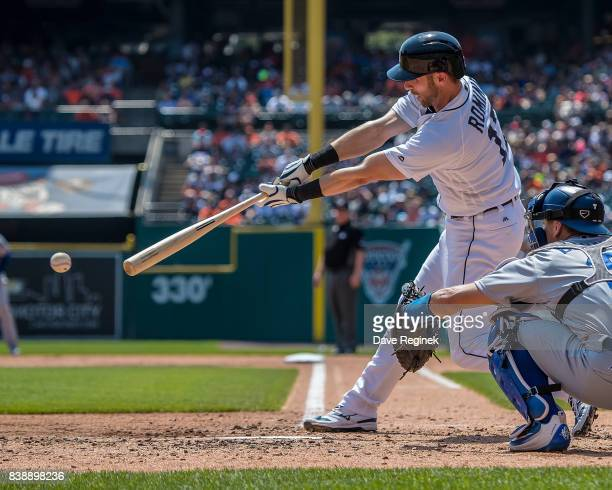 Andrew Romine of the Detroit Tigers swings and makes contact in the fourth inning against the Los Angeles Dodgers during a MLB game at Comerica Park...