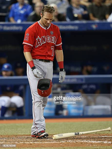 Andrew Romine of the Los Angeles Angels of Anaheim reacts after striking out in the eighth inning during MLB game action against the Toronto Blue...