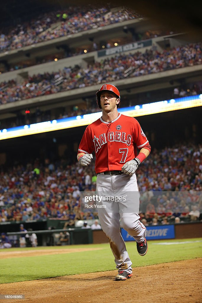 Andrew Romine #7 of the Los Angeles Angels of Anaheim returns to the in the dugout after scoring in the third inning against the Texas Rangers at Rangers Ballpark in Arlington on September 27, 2013 in Arlington, Texas.