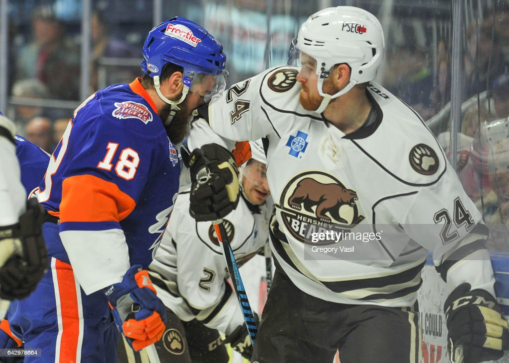 Andrew Rowe #18 of the Bridgeport Sound Tigers is hit with an elbow from Brad Malone #24 of the Hershey Bears during a game at the Webster Bank Arena on February 19, 2017 in Bridgeport, Connecticut.