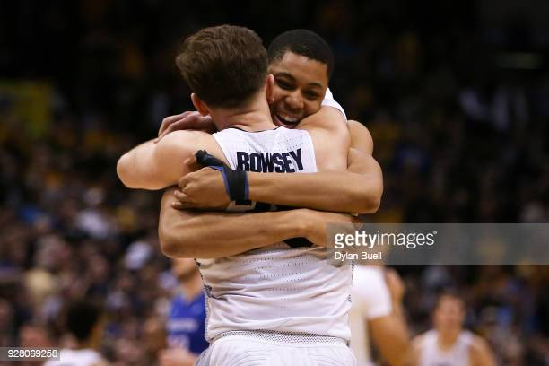 Andrew Rowsey and Greg Elliott of the Marquette Golden Eagles embrace after beating the Creighton Bluejays 8581 at the Bradley Center on March 3 2018...