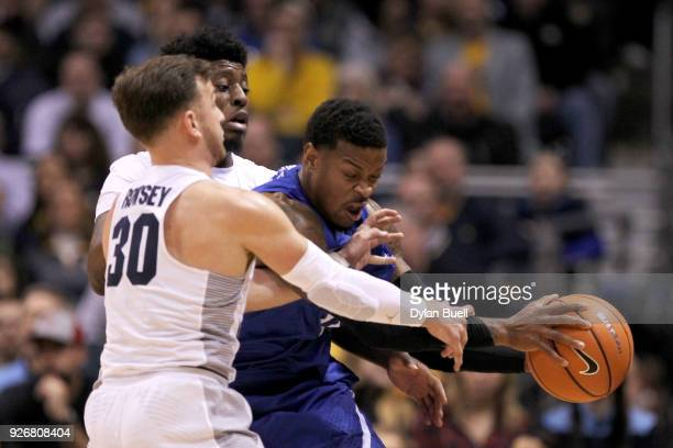 Andrew Rowsey and Sacar Anim of the Marquette Golden Eagles pressure Marcus Foster of the Creighton Bluejays in the first half at the BMO Harris...