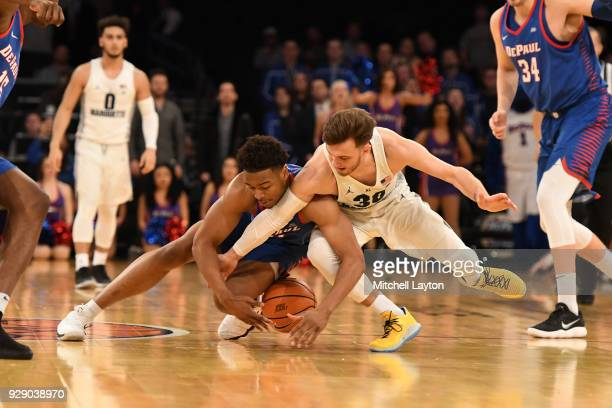 Andrew Rowsey of the Marquette Golden Eagles and Eli Cain of the DePaul Blue Demons fight for a loose ball during the first round of the Big East...
