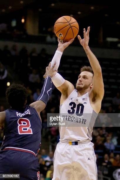 Andrew Rowsey of the Marquette Golden Eagles attempts a shot while being guarded by Shamorie Ponds of the St John's Red Storm in the first half at...