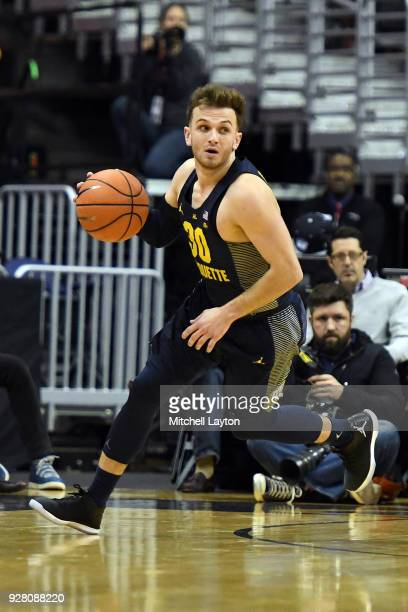 Andrew Rowsey of the Marquette Golden Eagles dribbles up court during a college basketball game against the Georgetown Hoyas at the Capital One Arena...