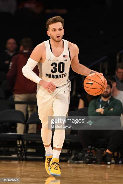 Andrew Rowsey of the Marquette Golden Eagles dribbles up court during the 1st round of the Big East Basketball Tournament against the DePaul Blue...