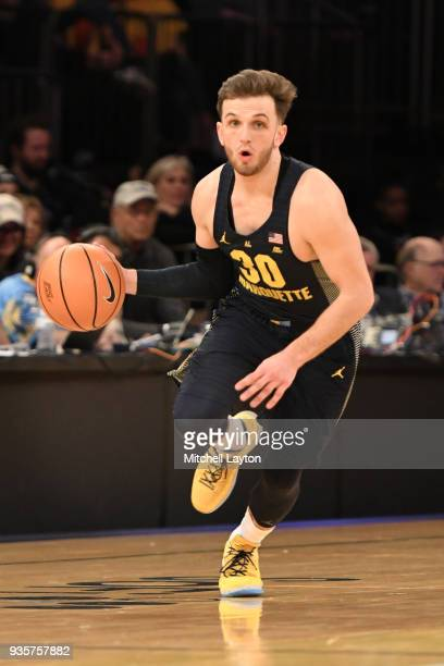 Andrew Rowsey of the Marquette Golden Eagles dribbles up court during the quarterfinal round the Big East Men's Basketball Tournament against the...