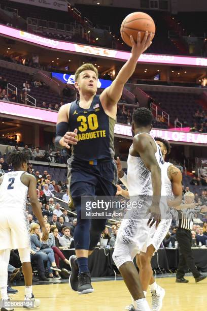 Andrew Rowsey of the Marquette Golden Eagles drives to the basket during a college basketball game against the Georgetown Hoyas at the Capital One...