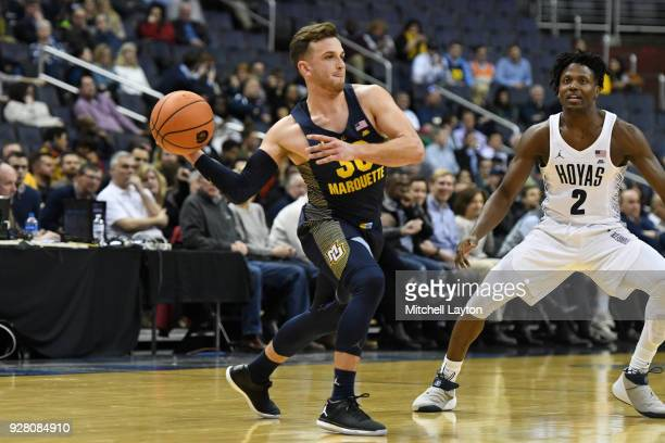 Andrew Rowsey of the Marquette Golden Eagles passes the ball during a college basketball game against the Georgetown Hoyas at the Capital One Arena...