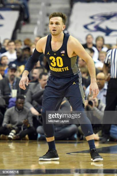 Andrew Rowsey of the Marquette Golden Eagles plays defense during a college basketball game against the Georgetown Hoyas at the Capital One Arena on...