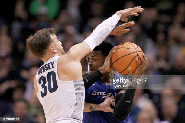 Andrew Rowsey of the Marquette Golden Eagles pressure Marcus Foster of the Creighton Bluejays in the first half at the BMO Harris Bradley Center on...