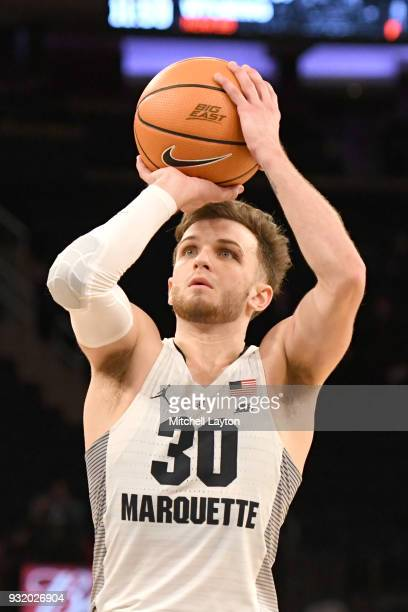 Andrew Rowsey of the Marquette Golden Eagles takes a foul shot during the 1st round of the Big East Basketball Tournament against the DePaul Blue...