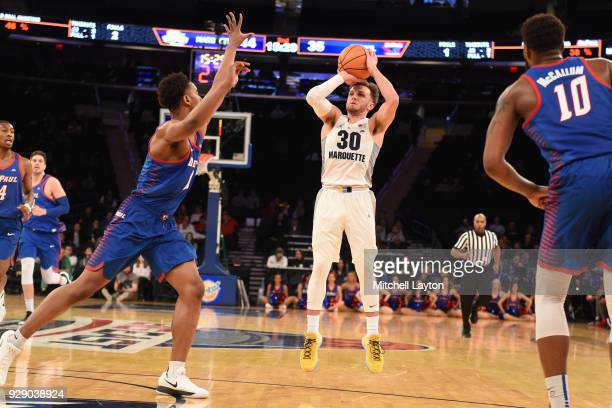 Andrew Rowsey of the Marquette Golden Eagles takes a jump shot during the first round of the Big East Men's Basketball Tournament against the DePaul...