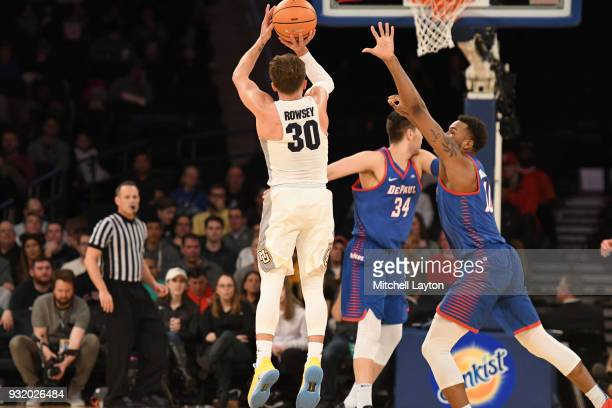 Andrew Rowsey of the Marquette Golden Eagles takes a jump shot during the 1st round of the Big East Basketball Tournament against the DePaul Blue...