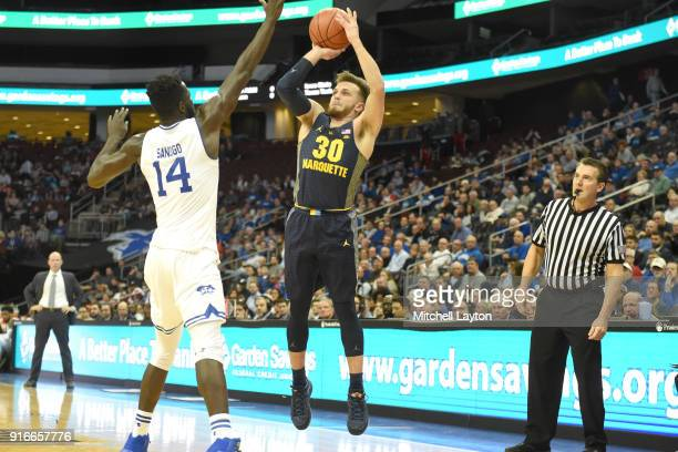 Andrew Rowsey of the Marquette Golden Eagles takes a jump shot over Ismael Sanogo of the Seton Hall Pirates during a college basketball game at the...