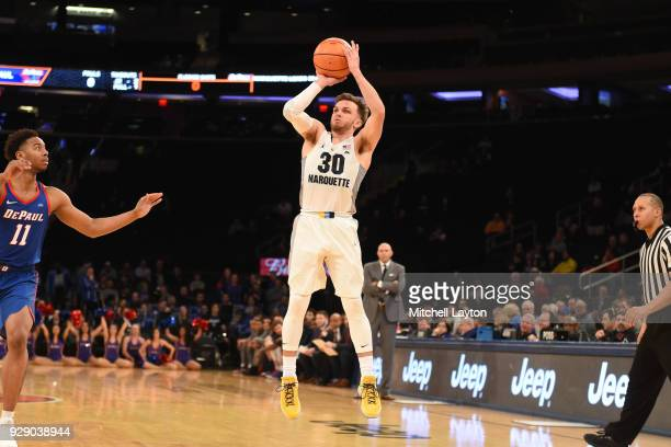Andrew Rowsey of the Marquette Golden Eagles takes a jump shot the first round of the Big East Men's Basketball Tournament against the DePaul Blue...