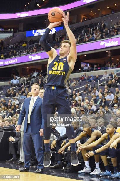 Andrew Rowsey of the Marquette Golden Eagles takes a jumpshot during a college basketball game against the Georgetown Hoyas at the Capital One Arena...
