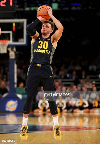 Andrew Rowsey of the Marquette Golden Eagles takes a shot in the first half against the Villanova Wildcats during quarterfinals of the Big East...