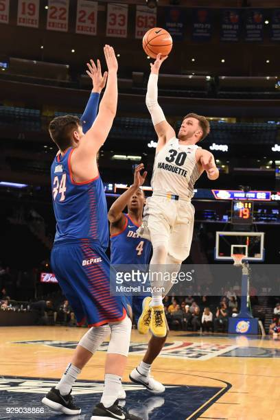 Andrew Rowsey of the Marquette Golden Eagles takes a shot over Marin Maric of the DePaul Blue Demons the first round of the Big East Men's Basketball...