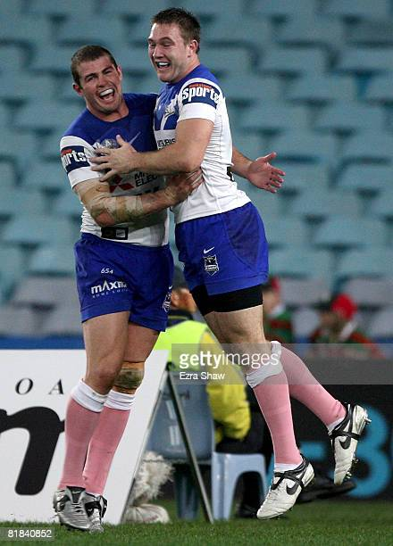 Andrew Ryan of the Bulldogs congratulates teammate Brent Crisp after he scored a try during the round 17 NRL match between the Bulldogs and the South...