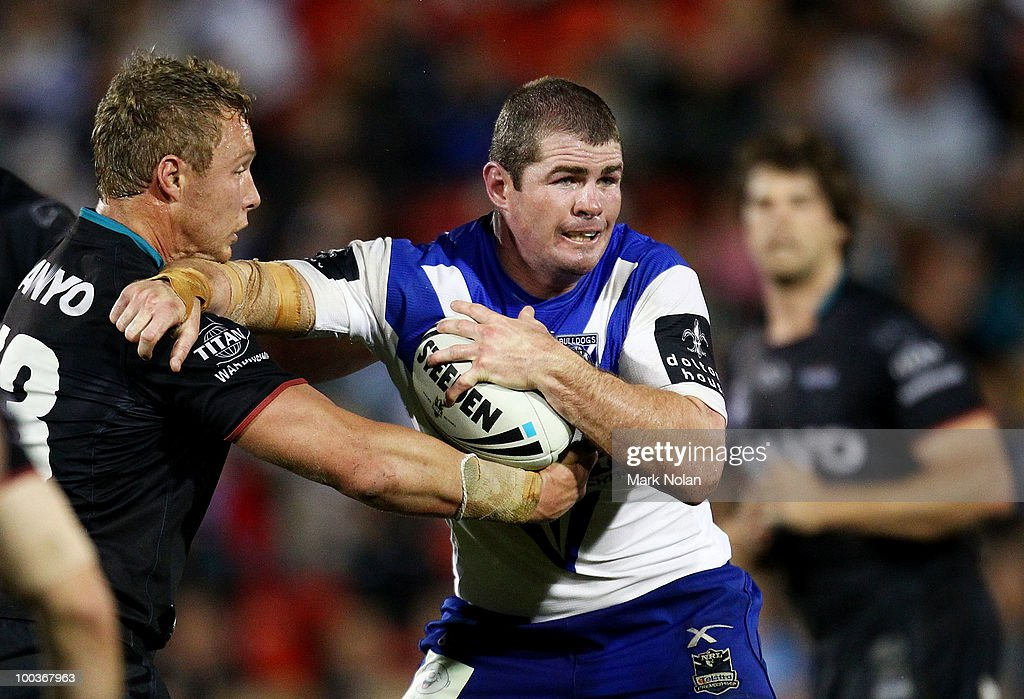 Andrew Ryan of the Bulldogs is tackled during the round 11 NRL match between the Penrith Panthers and the Canterbury Bulldogs at CUA Stadium on May 24, 2010 in Sydney, Australia.