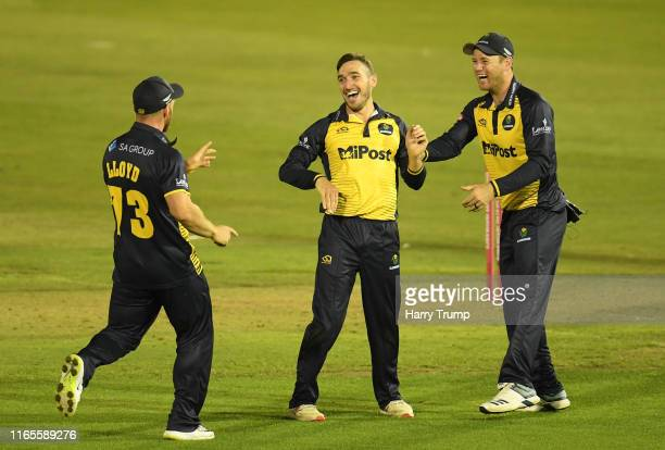 Andrew Salter of Glamorgan celebrates after taking the wicket of Jack Taylor of Gloucestershire during the Vitality Blast match between Glamorgan and...