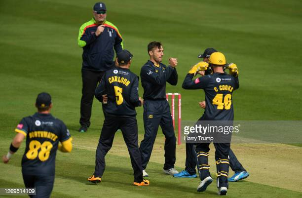 Andrew Salter of Glamorgan celebrates after taking the wicket of Chris Dent of Gloucestershire during the Vitality Blast match between...
