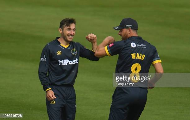 Andrew Salter of Glamorgan celebrates after taking the wicket of James Bracey of Gloucestershire with Graham Wagg of Glamorgan during the Vitality...