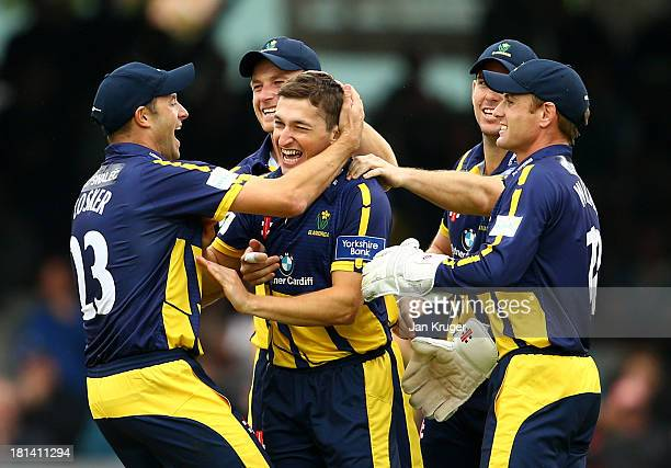 Andrew Salter of Glamorgan celebrates the wicket of Michael Lumb of Nottinghamshire with team mates during the Yorkshire Bank 40 Final match between...