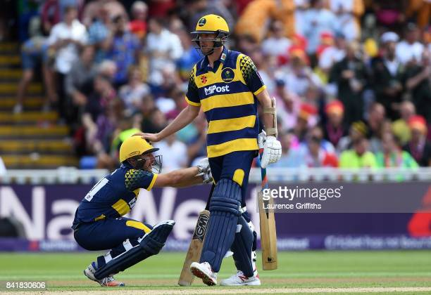 Andrew Salter of Glamorgan is consoled by team mate Michael Hogan following the NatWest T20 Blast SemiFinal match between Birmingham Bears and...