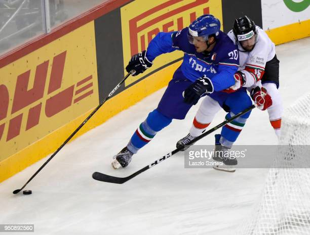 Andrew Sarauer of Hungary challenges Ivan Deluca of Italy during the 2018 IIHF Ice Hockey World Championship Division I Group A match between Italy...