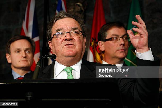 Andrew Saxton Parliamentary Secretary to the Minister of Finance left Jim James Flaherty Canada's finance minister center and Kevin Sorenson Canadas...