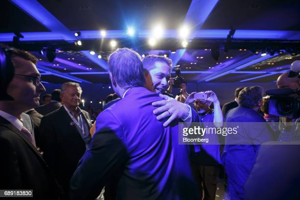 Andrew Scheer leader of Canada's Conservative Party center right hugs Maxime Bernier Member of Parliament and Conservative Party leader candidate...