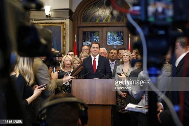 Andrew Scheer leader of Canada's Conservative Party center speaks to members of the media following the tabling of the federal budget on Parliament...