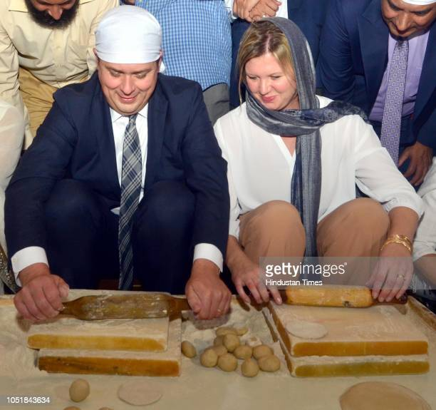 Andrew Scheer Leader Of Opposition in Canada along with his wife Jill Scheer prepares food for langar at Golden Temple on October 10 2018 in Amritsar...