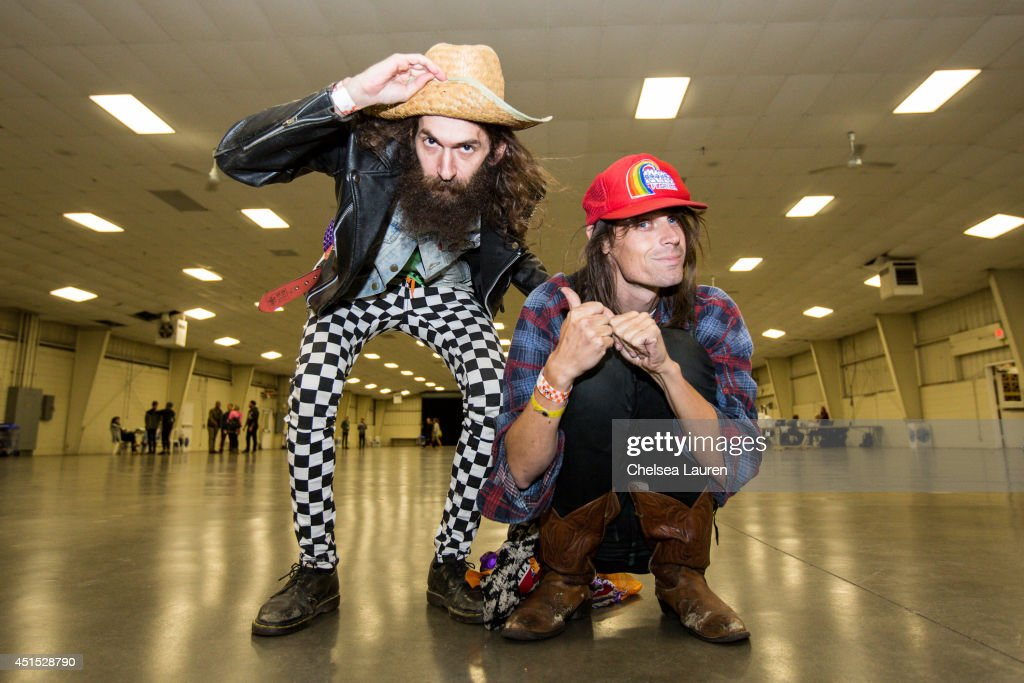 Andrew Schwartz (L) and TV personality Jesse Camp pose backstage during the Vans Warped Tour on June 22, 2014 in Ventura, California.