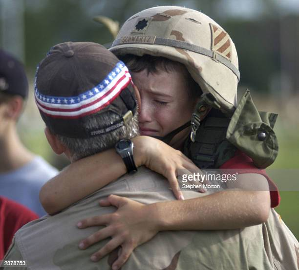 Andrew Schwartz hugs his father, U.S. Army Lt. Col Eric Schwartz at a welcome home ceremony August 7, 2003 at Fort Stewart, Georgia. Schwartz was...