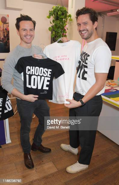 Andrew Scott and Ben Aldridge volunteer during Match Fund day at the 'Choose Love' shop for Help Refugees in Covent Garden on December 13 2019 in...