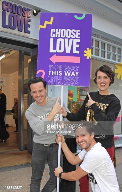Andrew Scott Ben Aldridge and Phoebe WallerBridge volunteer during Match Fund day at the 'Choose Love' shop for Help Refugees in Covent Garden on...
