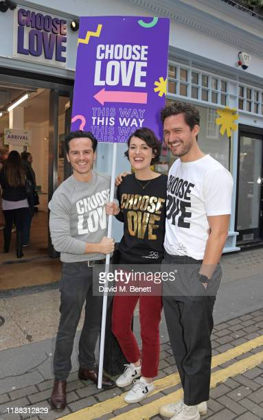 Andrew Scott Phoebe WallerBridge and Ben Aldridge volunteer during Match Fund day at the 'Choose Love' shop for Help Refugees in Covent Garden on...