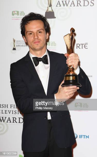 Andrew Scott poses in the Press Room after receiving the Best supporting TV actor award for his role in 'Sherlock' at the Irish Film and Television...